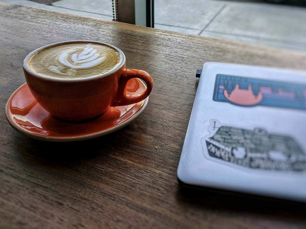 Coffee and laptop at my favorite coffeeshop, Calvin Fletchers